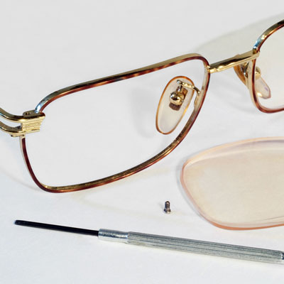 Glasses with lens and screwdriver